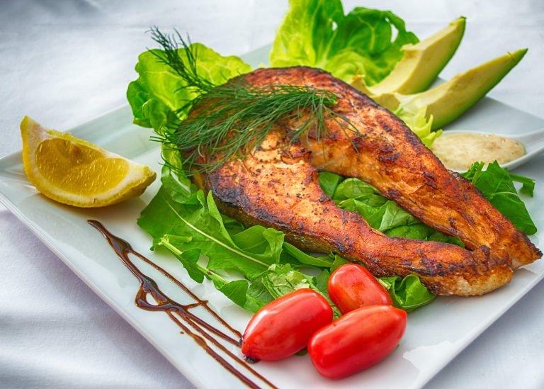 Fish cooked in microwave oven equipped with charcoal convection
